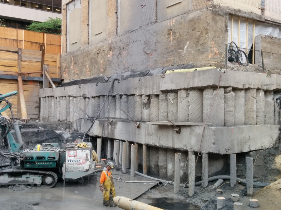 Secant pile wall excavation next to a building in Montreal Canada