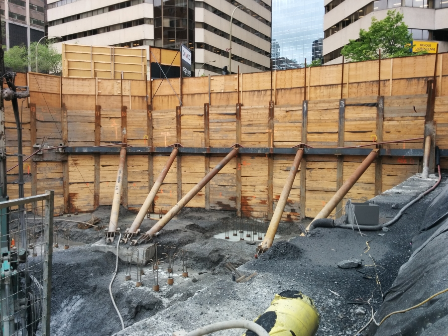 Soldier pile wall excavation in Montreal, Canada with rakers and tiebacks