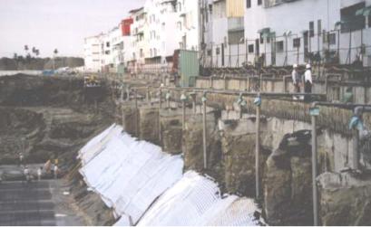 T-panel diaphragm wall excavation during berm excavation